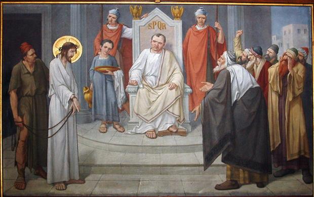 """Veertien kruiswegstaties, statie 1: """"Jezus wordt ter dood veroordeeld"""" (1917), Nicolaas Poland (1862-1949) - olieverf op doek, 120x172cm. De 14e (laatste) statie """"De graflegging"""" is gesigneerd en gedateerd """"N. Poland - 1917""""."""